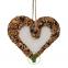 Coeur à suspendre avec graines pour oiseaux